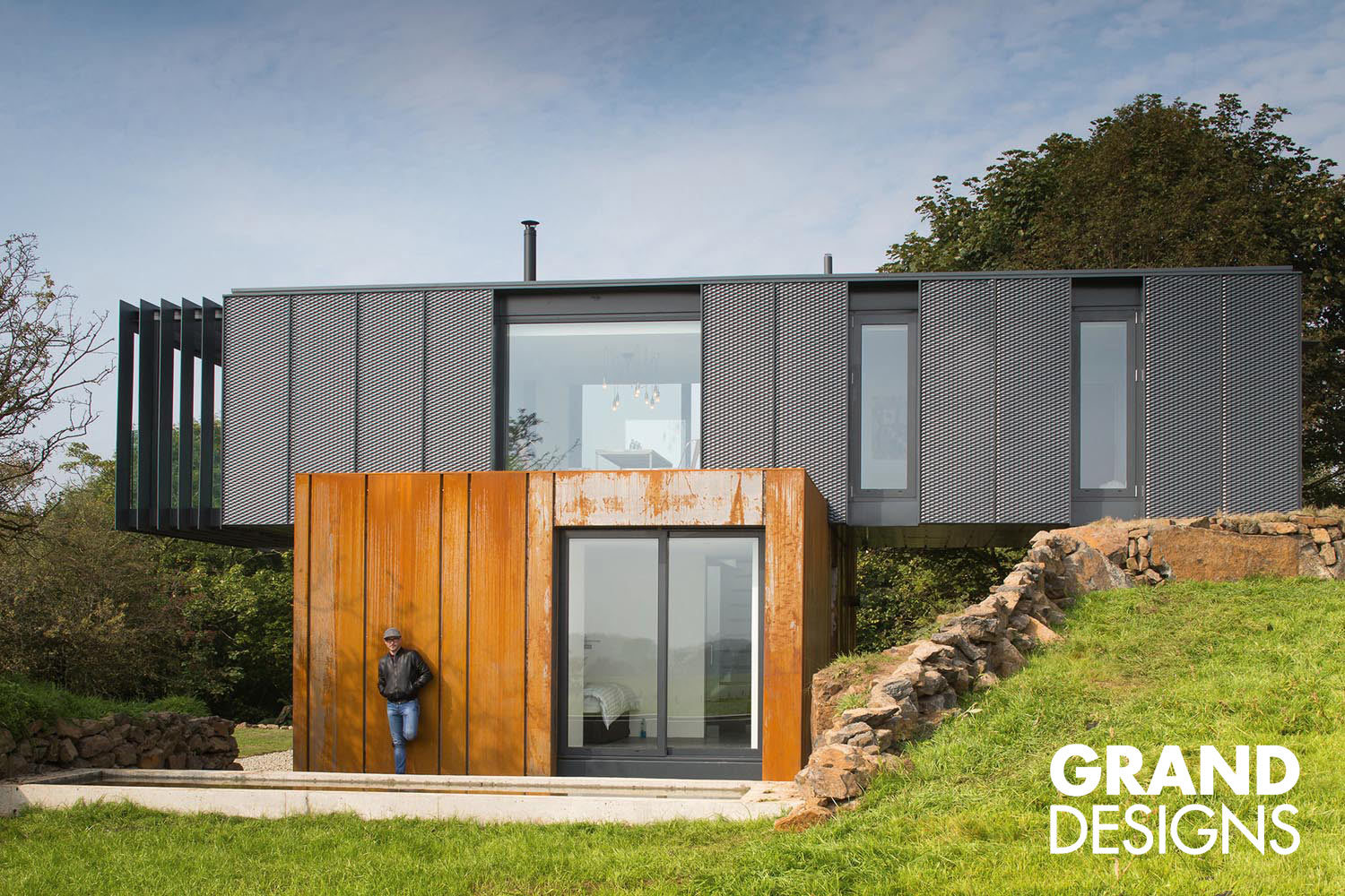 Grand Design by Kevin McCloud. This series takes you though the journey of building a sustainable home from scratch - designing, financing, haggling, fights & disagreements to the final achievement by common folks.